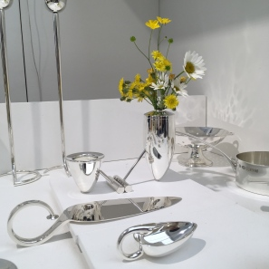 Silver posy vase filled with meadow blooms